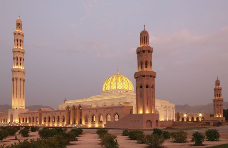 Lit up Grand Mosque at sunset, Muscat, Oman