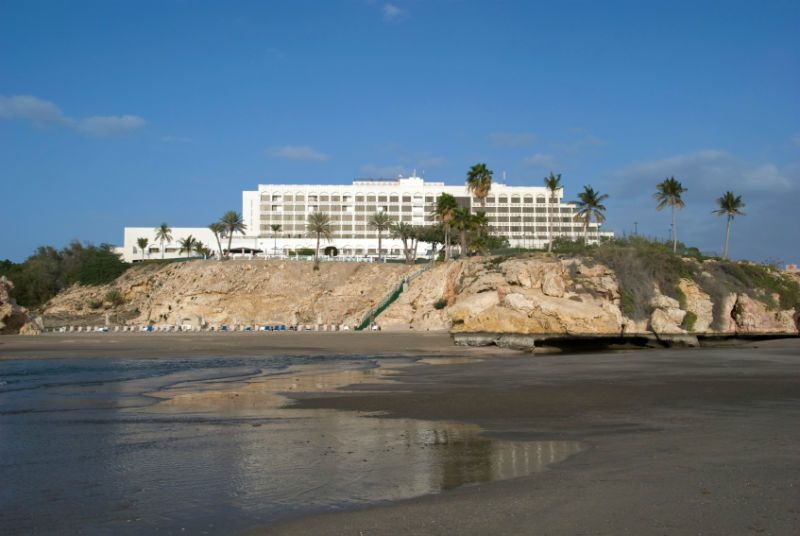Hotel and Palm Trees on a Rocky Dune, Muscat