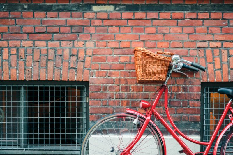 Red Classic Bicycle Against Wall in Copenhagen, Denmark