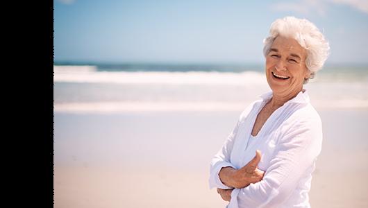 Senior woman smiling on the beach