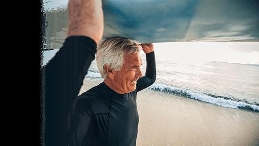 Stroke travel insurance banner - smiling senior surfer