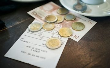 A bill in europe with euros left as tip