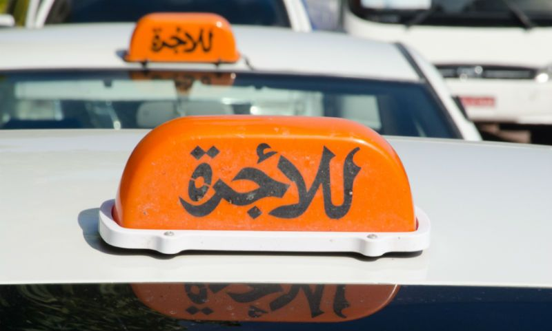 Arabic Taxi signs on cabs in Muscat, Oman