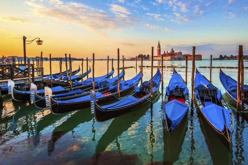 Venice with famous Gondolas at Sunset, Italy