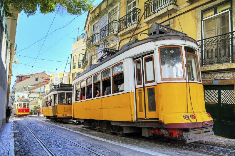 Yello trams on street in Lisbon, Portugal