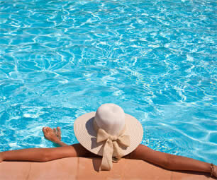 Lady in a sunhat in a swimming pool