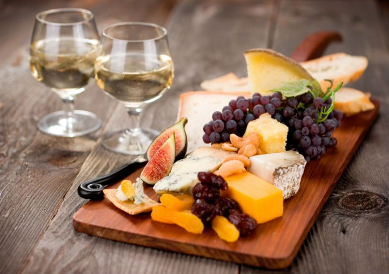 Grapes, Cheese, Figs and Fruit on a Breadboard with Wine, Dublin, Ireland