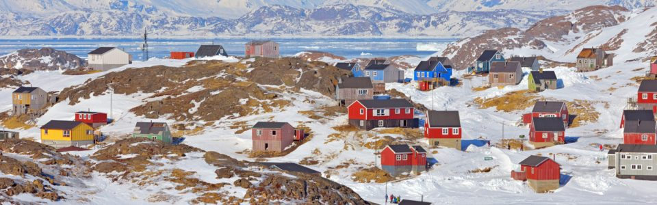 Red and blue houses in the mountains of Greenland