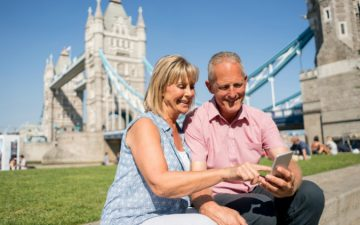Couple using London travel app