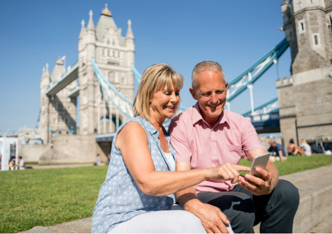 Couple using London travel app