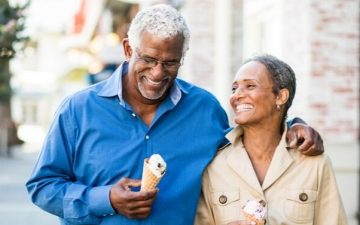 senior couple walking with ice cream