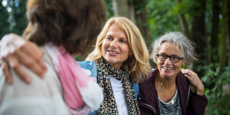 senior female friends walking