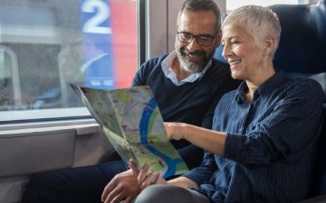 mature couple travelling by train