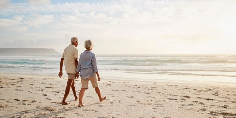seniors walking together on the beach