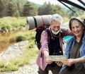 Older couple looking at map before hiking